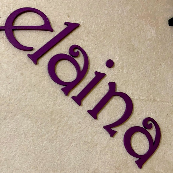 Wooden letters spell ELIANA ELAINA or ELI & ANA